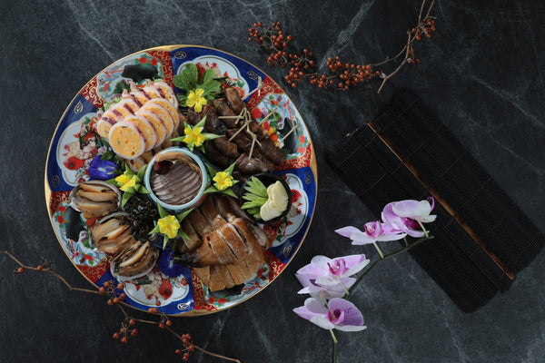 Mountain and See House Platter (a dish containing a variety of different poultry and seafood)