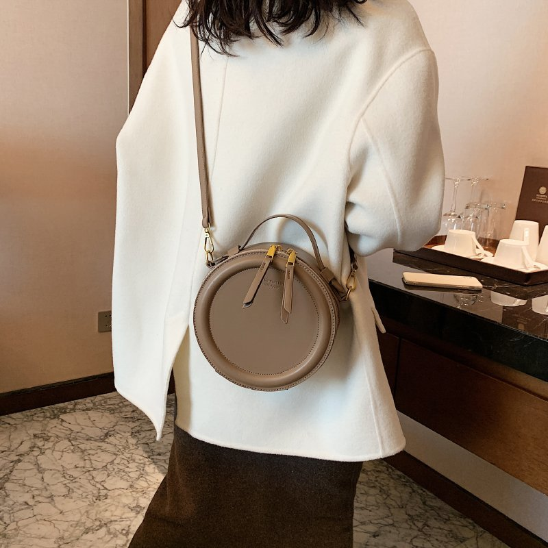 Designer Round Shoulder Bag - Slick Neat