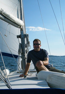 Indie Marine President Shane standing on the deck of his catamaran
