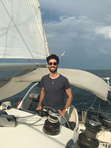 Indie Marine Marketing Coordinator Chris sailing a catamaran..