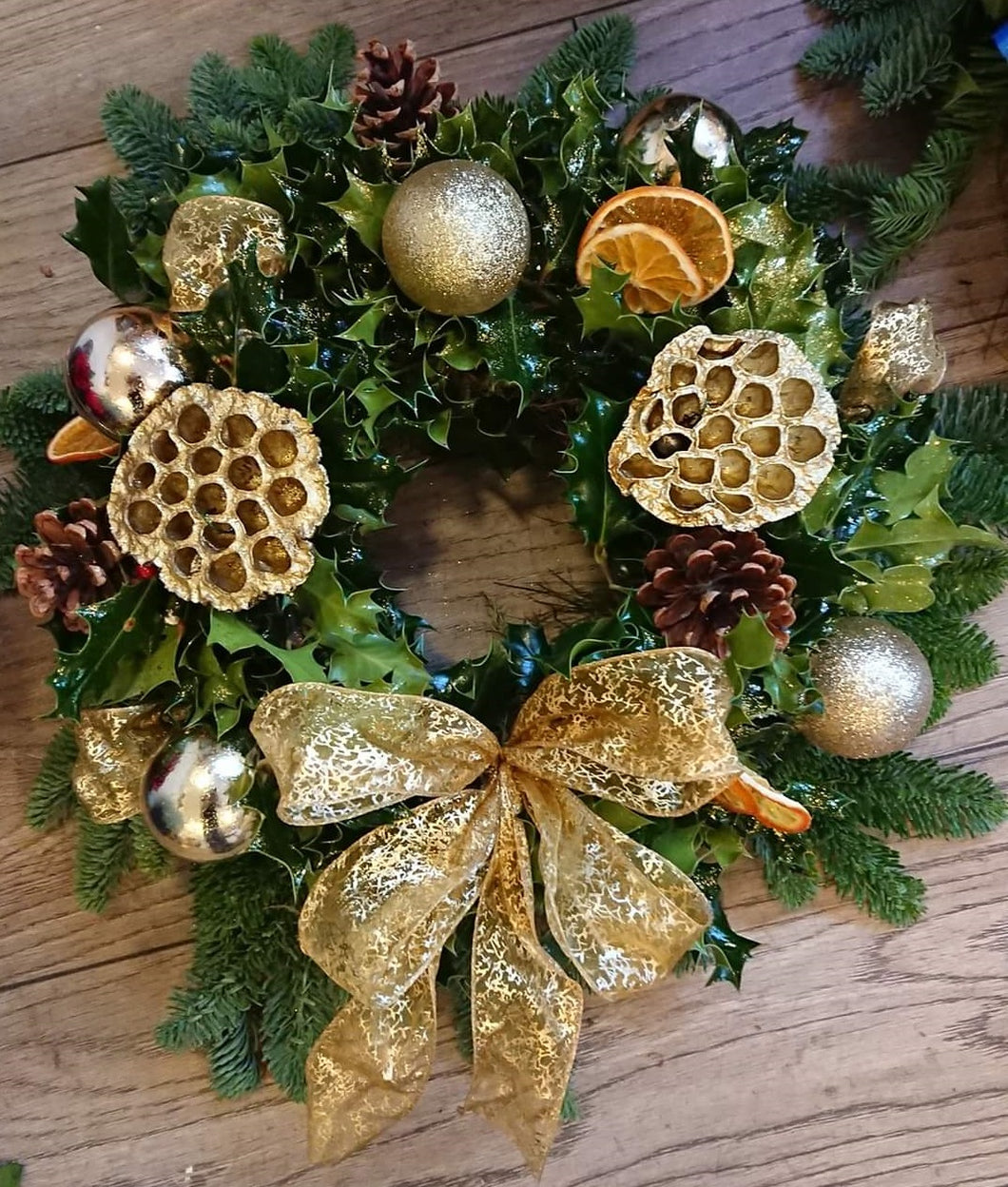 Gold holly wreath
