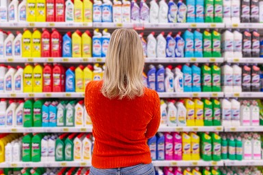 Woman viewing cleaning products