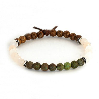 Positivity aromatherapy bracelet with green and pink gemstones