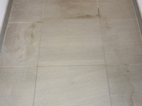 Removing spot stains from grout and tiles