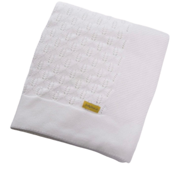 A plain white knitted organic cotton blanket