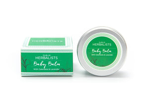 A silver tin of baby balm with a green and white label on the lid and a green and white box.