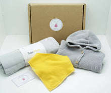 Load image into Gallery viewer, Natural coloured gift box with the My Little Pear Tree logo circular sticker on the lid, the sticker has a purple boarder with a pink pear in the centre with the writing My little Pear Tree, a grey knitted hooded cardigan, a yellow bandana style bib, a grey muslin cloth and a My Little Pear Tree card.