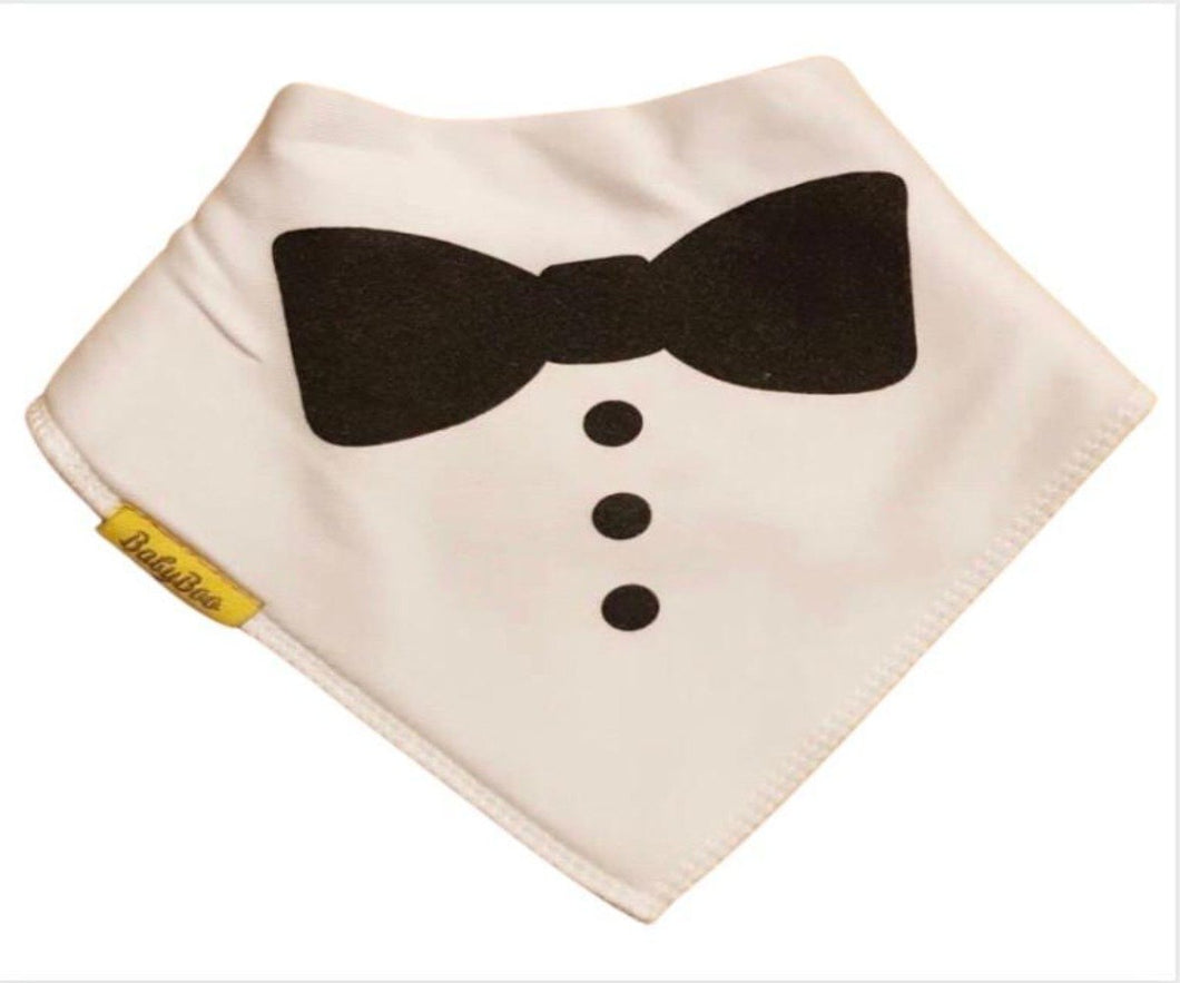 white bandana style bib with black dickie pattern and 3 black buttons down the front centre