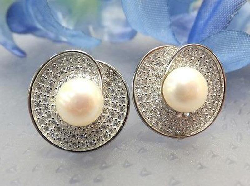 Woman's natural pearl earrings