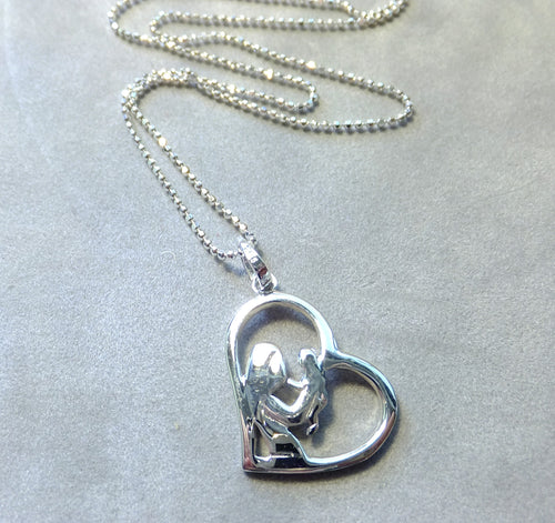 MOther and child heart pendant in sterling silver