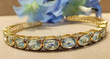 Load image into Gallery viewer, Blue topaz and gold bracelet