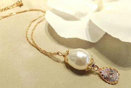 Golden pearl drop necklace