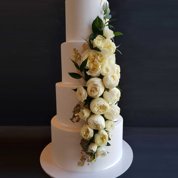 Fondant covered wedding cake4 tiers increased height 23ct gold leaf detail
