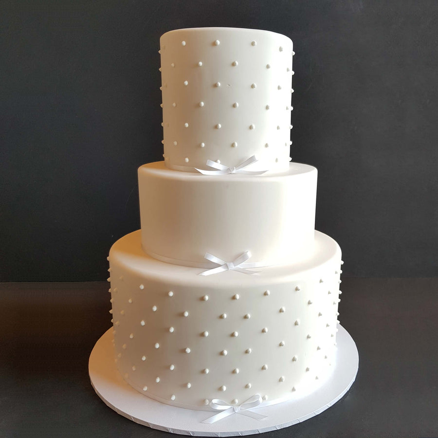Fondant covered wedding cake 3 tier – 2 x increased height 1 x standard height piping detail