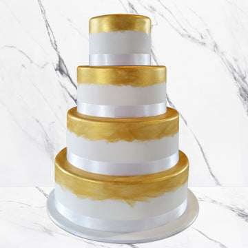 Fondant covered wedding cake – hand-painted gold shimmer