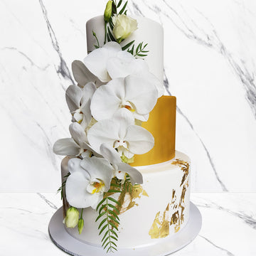 Fondant covered wedding cake – 3 tier gold shimmer and gold spec