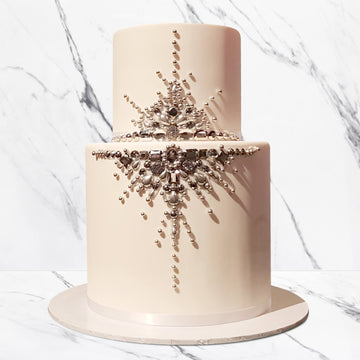 Fondant covered wedding cake with jewel details