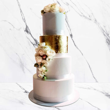 Fondant covered wedding cake – waffle cone detail with gold leaf tier