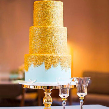 Fondant covered wedding cake baby blue 3 tier cake covered in gold shimmer sanding sugar