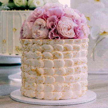Marshmallow effect buttercream wedding cake with florals