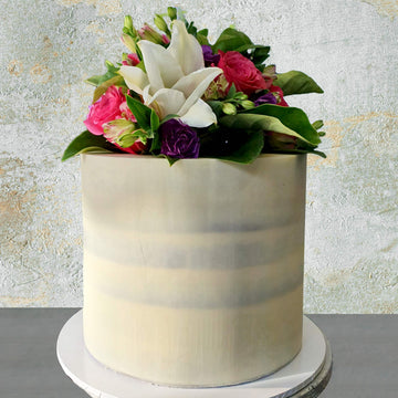 Naked cake white chocolate ganache with fresh florals