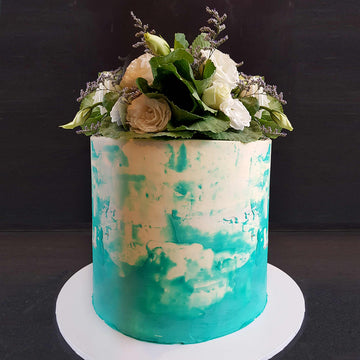 White and blue watercolour buttercream cake with fresh florals