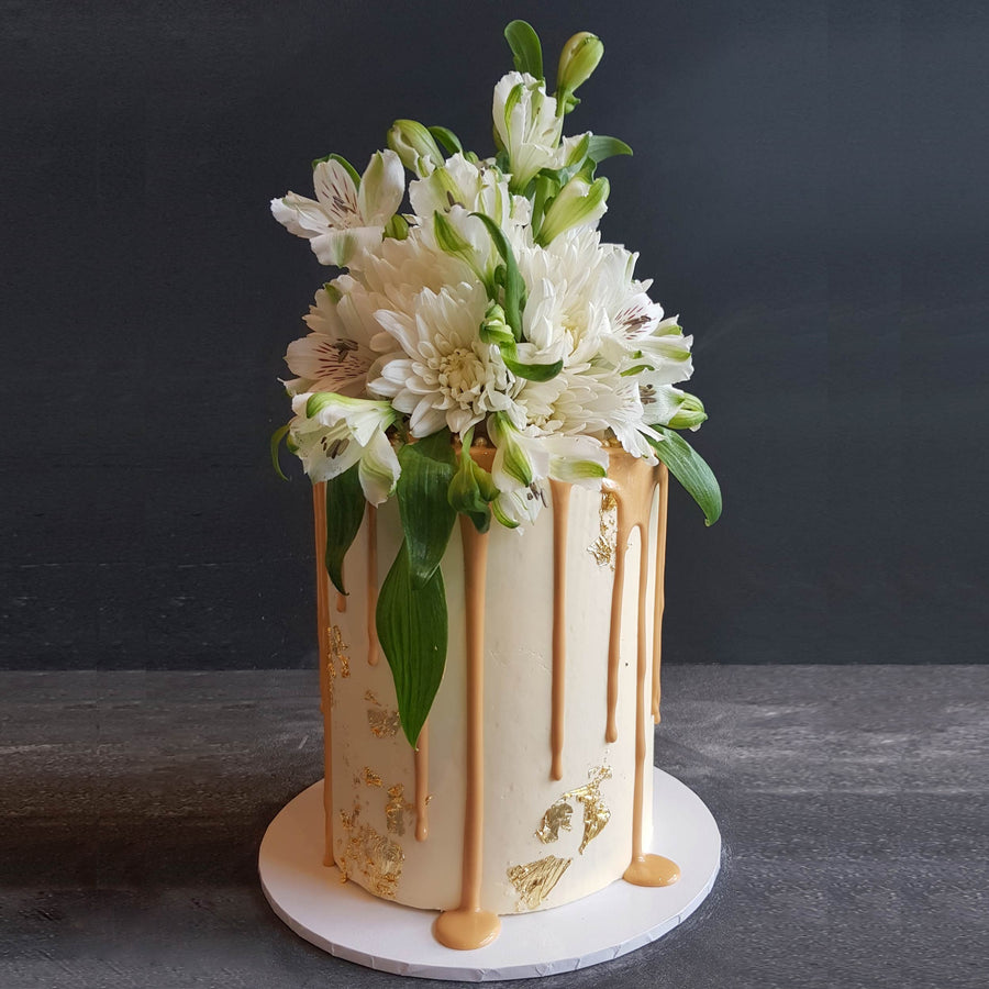 White choc ganache cake with caramel and florals