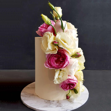 White chocolate ganache cake with cascading fresh florals