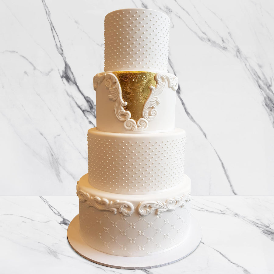 Fondant covered wedding cake – 4 tiers increased height with piped details and 23ct gold leaf