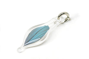 small blown glass charm with cruelty-free blue parrot feather inside