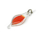 Larger blown glass capsule charm with red-orange parrot feather inside