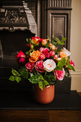 Realistic arrangement of artificial Roses and seasonal greenery in a dusky pink vase perfect for the home or to gift.