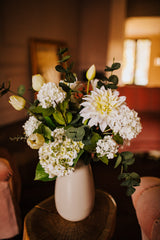 Realistic artificial arrangement of Dahlia, Tulips, Alstroemeria, Hydrangea, Viburnum and Eucalyptus foliage in an sleek off white vase perfect for the home or to gift.