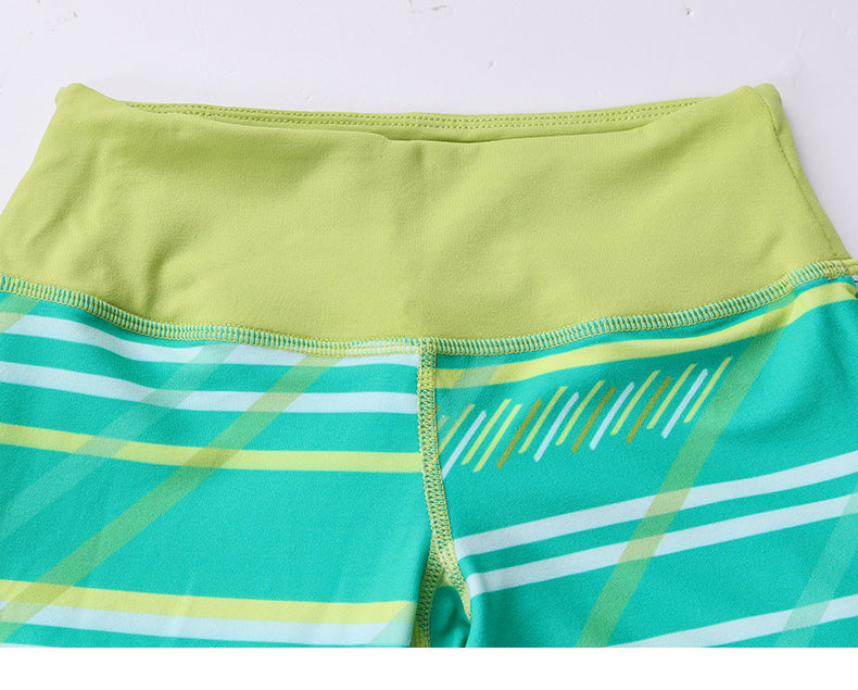Cozy Orange Dharma Leggings in Serenity Stripe Green and Chartreuse - Front Waist