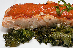 Salmon with Romesco Sauce over Kale