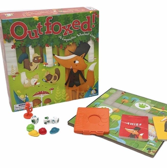 Outfoxed board game placed together with packaging on white background
