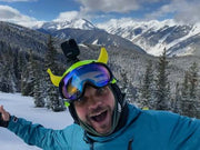 Banana on a ski helmet with mountains in the background