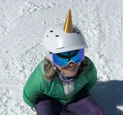 Unicorn horn for a snowboarding helmet with a snow background