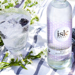 isle organic wild blackberry sparkling artesian water in glass