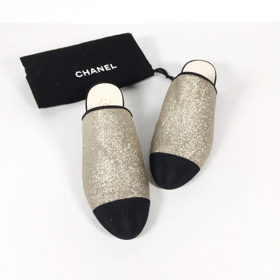 Chanel mules, gold shimmer with black toes
