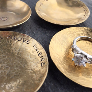 Four bronze ring dishes by Red Door Metalworks