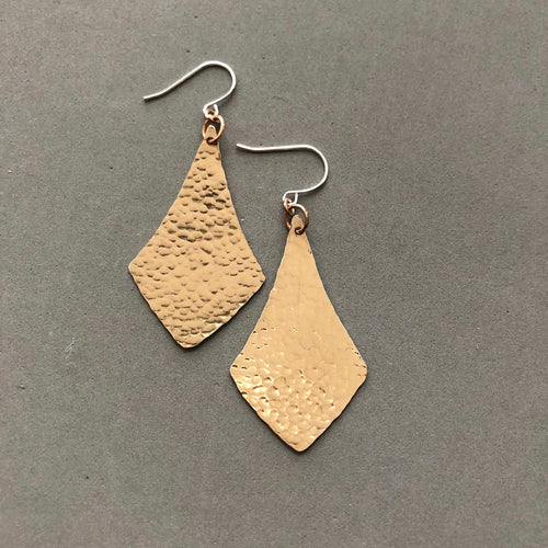 Hammered bronze arabesque on sterling earwire earrings by Red Door Metalworks
