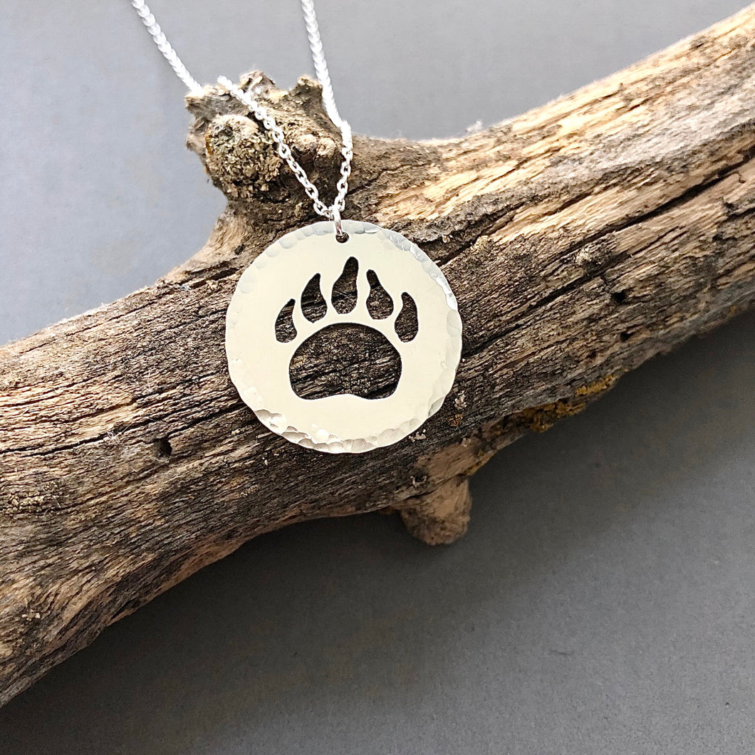 Bear paw cutout in sterling silver disc necklace by Red Door Metalworks