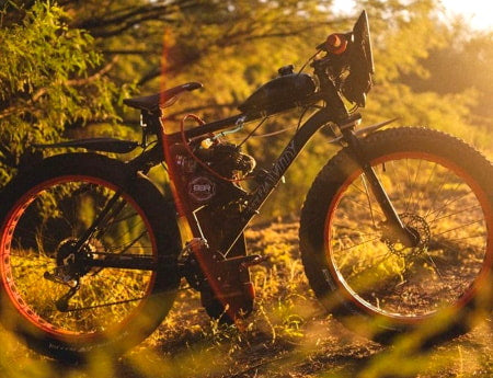 Off-road 2-stroke motorized bicycle with heavy-duty fat tires.