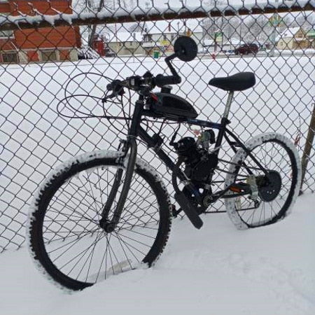 2-stroke motorized bike with upgraded low end torque specs for riding in the snow.