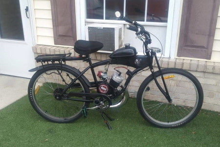 2-stroke motorized bicycle with high-performance carburetor.