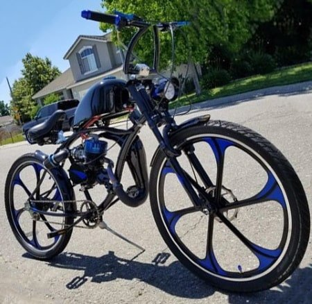 2-stroke motorized bike with mag wheels and expansion chamber upgrades.
