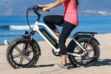 Riding a 20-inch electric bike on the beach.