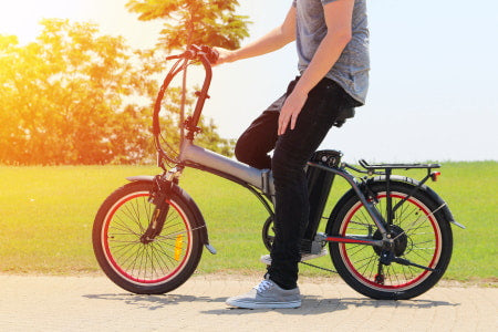 Riding a 20-inch electric bike at the park.