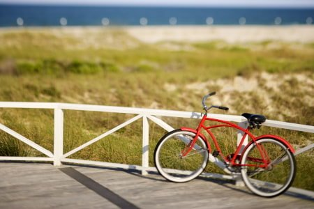 This is a picture of a beach cruiser bike on the boardwalk.